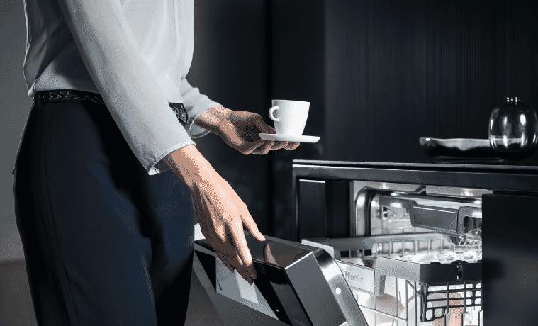 Semi-integrated, Miele dishwasher in stylish, modern kitchen.