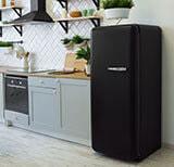 Modern White Kitchen With Black Appliances