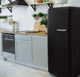 White Kitchen With Black Appliances